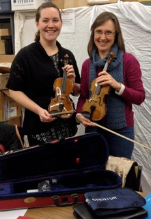 Shannon Linton and Deborah Henderson proudly displaying our first two 1/4 size violins